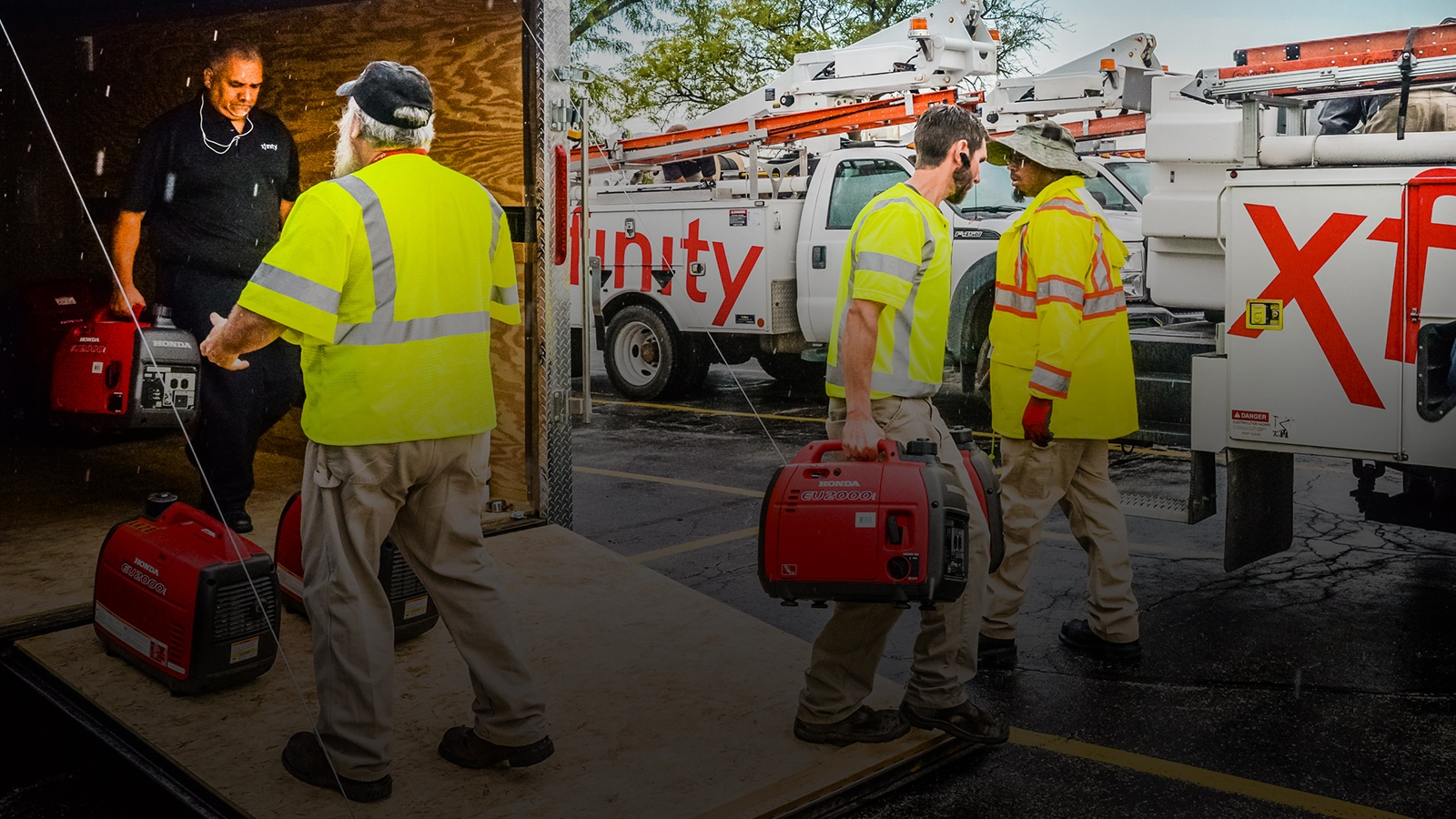 Xfinity technicians load a truck with supplies
