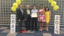 Robert Handy of Miami, Miami-Dade County Public Schools is presented with a scholarship.